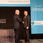 Dan Singleton, CEO of Transient Plasma Systems, accepts the WWL Orcelle® Award from Ray Fitzgerald of WWL.