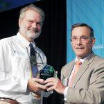 Tony Frudakis of Okeanos Technologies accepts the 2014 Gulfstream Navigator Award from Joe Lombardo.